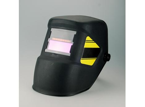 Auto-dardening welding helmet